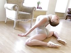 Gymnastic youthful shorthaired stunner shows skills