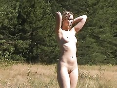 Outdoor young stunner swims and poses naked