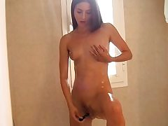 My promiscuous fledgling girlfriend plays with a faux-cock and my fuckpole