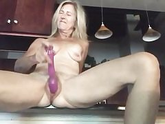 Nude blond opens up out her legs massaging beaver with a yam-sized dildo